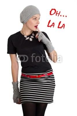 Bild einer jungen frauen mit hand an lippe - Stock Foto